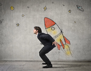 businessman strapped to rocket