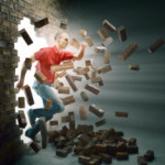 Man running through a brick wall
