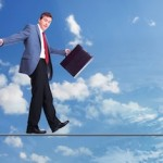Businessman walking on rope in the sky. Business concept.
