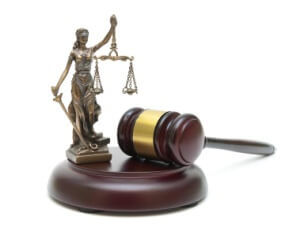 gavel and the statue of justice on a white background