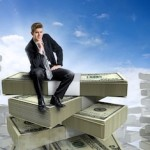 Businessman sitting on a pile of cash