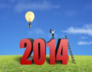 Businessman standing on top of 2014