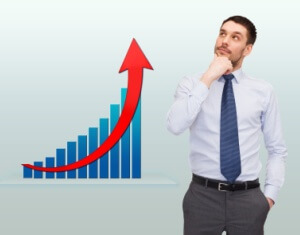 thinking young businessman with growth chart