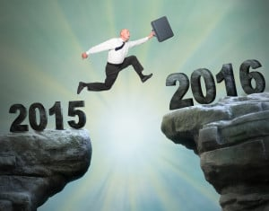 Businessman jumps to The New Year 2016