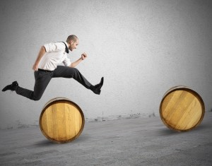 businessman jumping obstacles