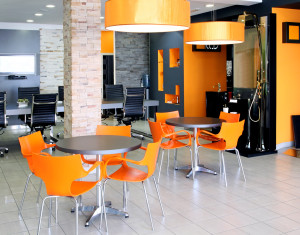 Modern office space with bright orange furniture