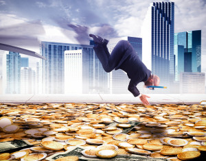 Businessman dives into a pool of money