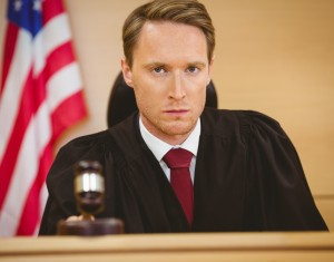 a judge about to bang gavel