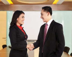 Business man and woman hand shake