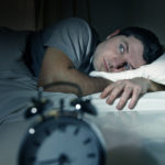 businessman suffering from insomnia