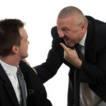 Businessman screaming at colleague