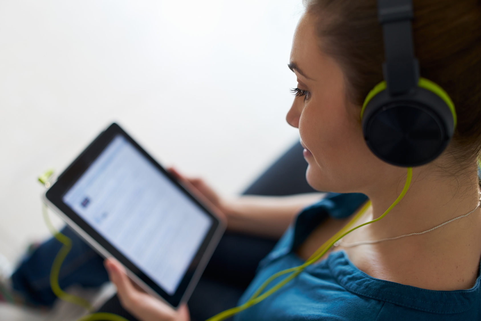 woman watches podcast on tablet