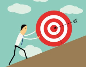 businessman pushing a target to the top