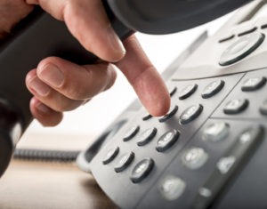 Closeup of dialing a number on a landline telephone