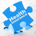 Health Insurance on puzzle background