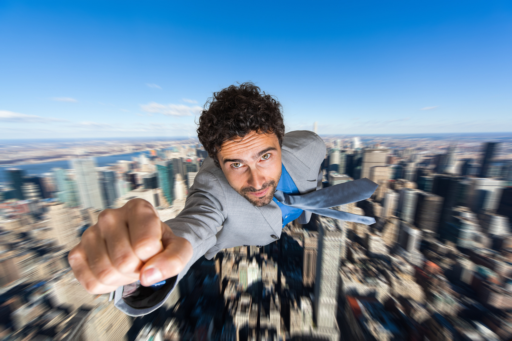 Businessman superhero flying above a city