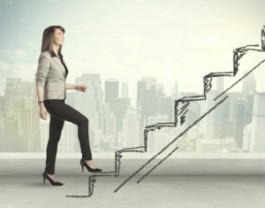 Business woman climbing steps