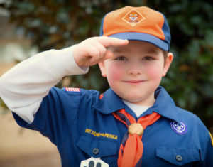 Cub Scout gives salute