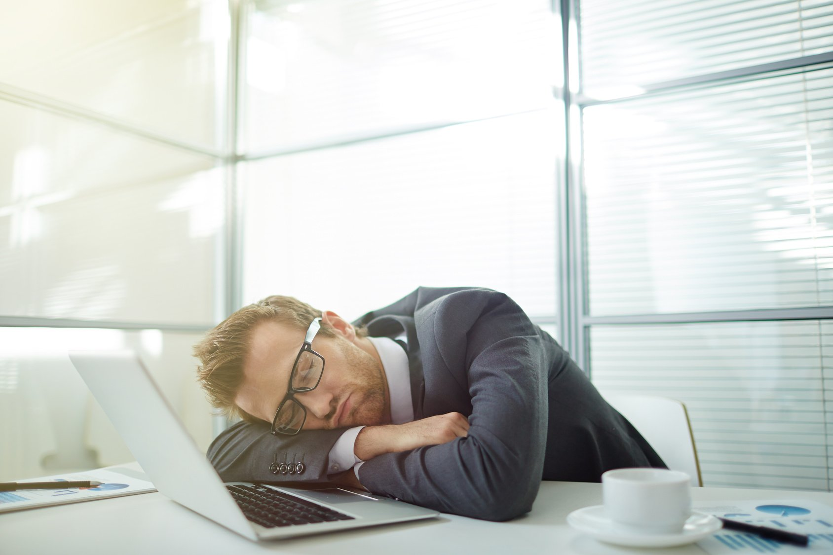 Businessman sleeping at his workplace