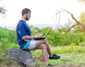 freelancer with laptop outdoors