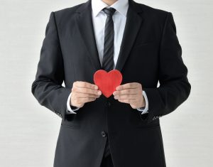 "Businessman with a red heart ""Laden ="" lazy"