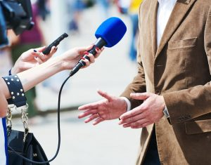 media reporter with microphone