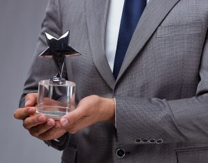 Businessman holding star award