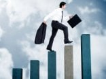 Young-businessman-climbing-on-bar-graph