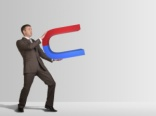 Businessman with giant magnet