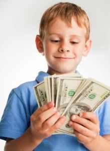 boy holding cash