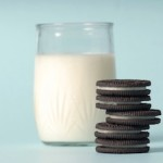 glass of milk and oreo cookies