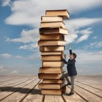 man climbing tower of books