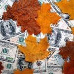cash and autumn leaves
