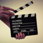 hand holding movie clapboard
