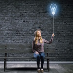 woman holding lightbulb balloon
