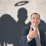 businessman with angel-shaped shadow