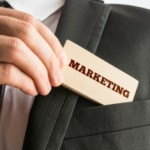 Businessman with a sign saying - Marketing