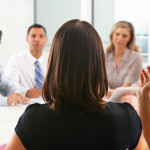 woman presenting to business team